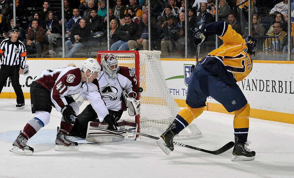 . A shot by Chris Mueller #17 of the Nashville Predators hits the post in front of goalie Jean-Sebastien Giguere #35 and Tyson Barrie #41 of the Colorado Avalanche at the Bridgestone Arena on April 2, 2013 in Nashville, Tennessee.  (Photo by Frederick Breedon/Getty Images)