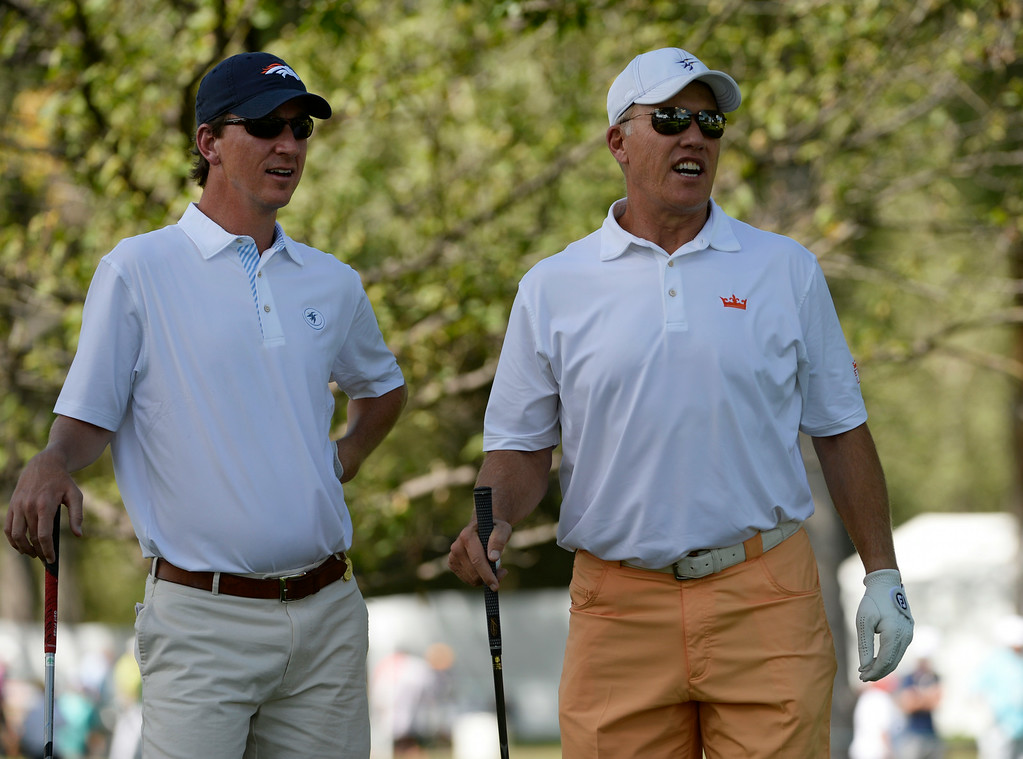 . CHERRY HILLS VILLAGE, CO. - SEPTEMBER 03:  Golf partners, Cooper Manning, left, and John Elway look over the #2 fairway before hitting their tee shots during the FedExCup BMW Championship Pro-Am at the Cherry Hills Country Club Wednesday, September 03, 2014. (Photo By Andy Cross / The Denver Post)