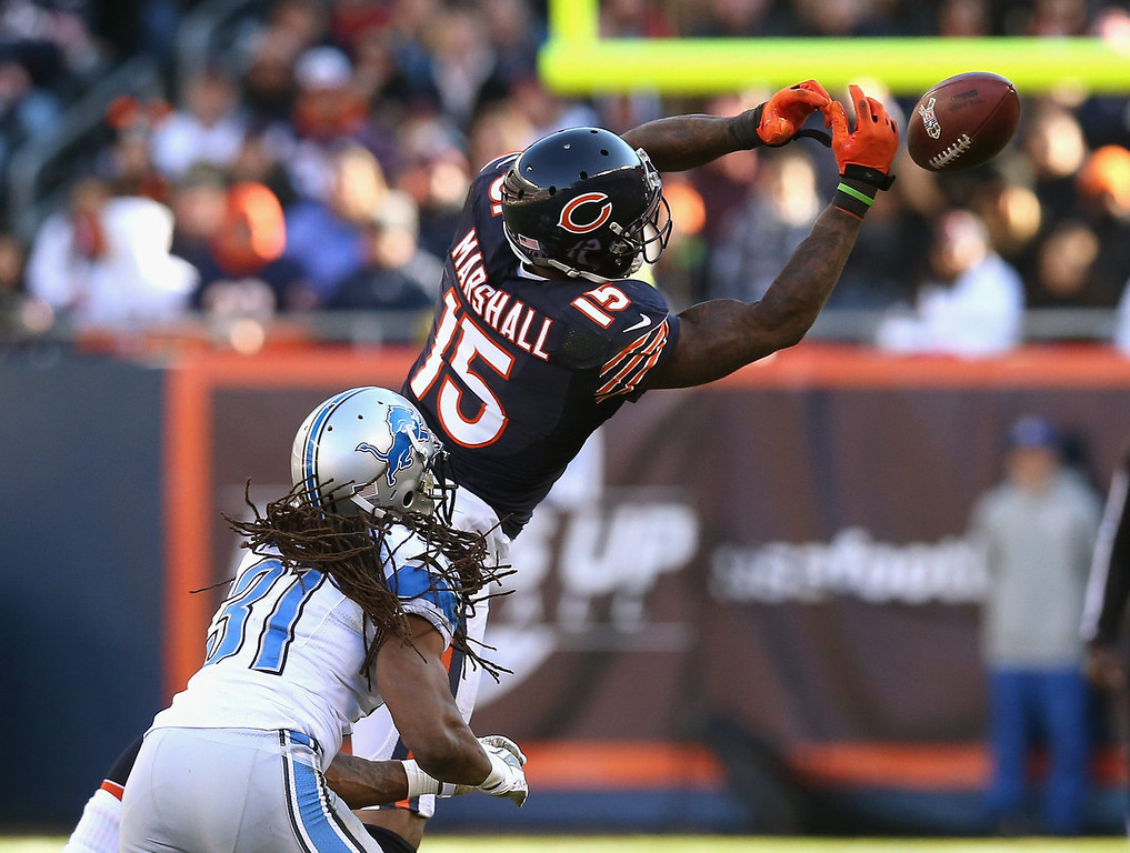 . Brandon Marshall #15 of the Chicago Bears misses a catch under pressure from Rashean Mathis #31 of the Detroit Lions at Soldier Field on November 10, 2013 in Chicago, Illinois. The Lions defeated the Bears 21-19. (Photo by Jonathan Daniel/Getty Images)