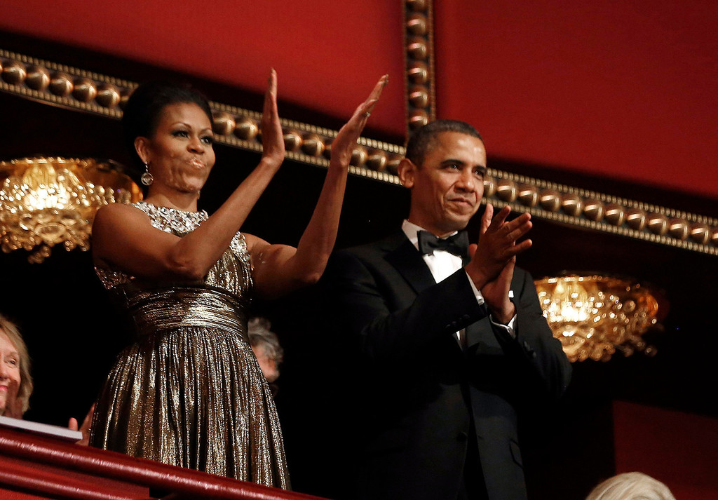 . U.S. President Barack Obama and first lady Michelle Obama applaud on the balcony as they attend the 2012 Kennedy Center Honors at the Kennedy Center in Washington, December 2, 2012.     REUTERS/Jason Reed