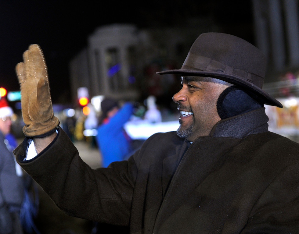 . DENVER, CO. - DECEMBER 06: Denver Mayor Michael Hancock waved to constituents as the 9News Parade of Lights kicked off Friday night, December 6, 2013. The weather was clear but temperatures dipped below zero. Photo By Karl Gehring/The Denver Post