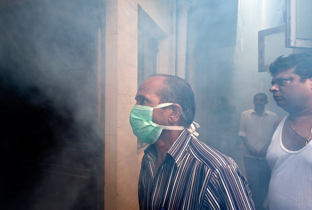 . An Indian Municipal health worker fumigates against mosquitoes at a neighborhood in New Delhi on October 3, 2013. Dengue fever is a mosquito-borne disease with no known cure or vaccination that strikes fear into the citizens of New Delhi when it arrives with the monsoon rains -- just as the scorching heat of the summer is subsiding.  MANAN VATSYAYANA/AFP/Getty Images
