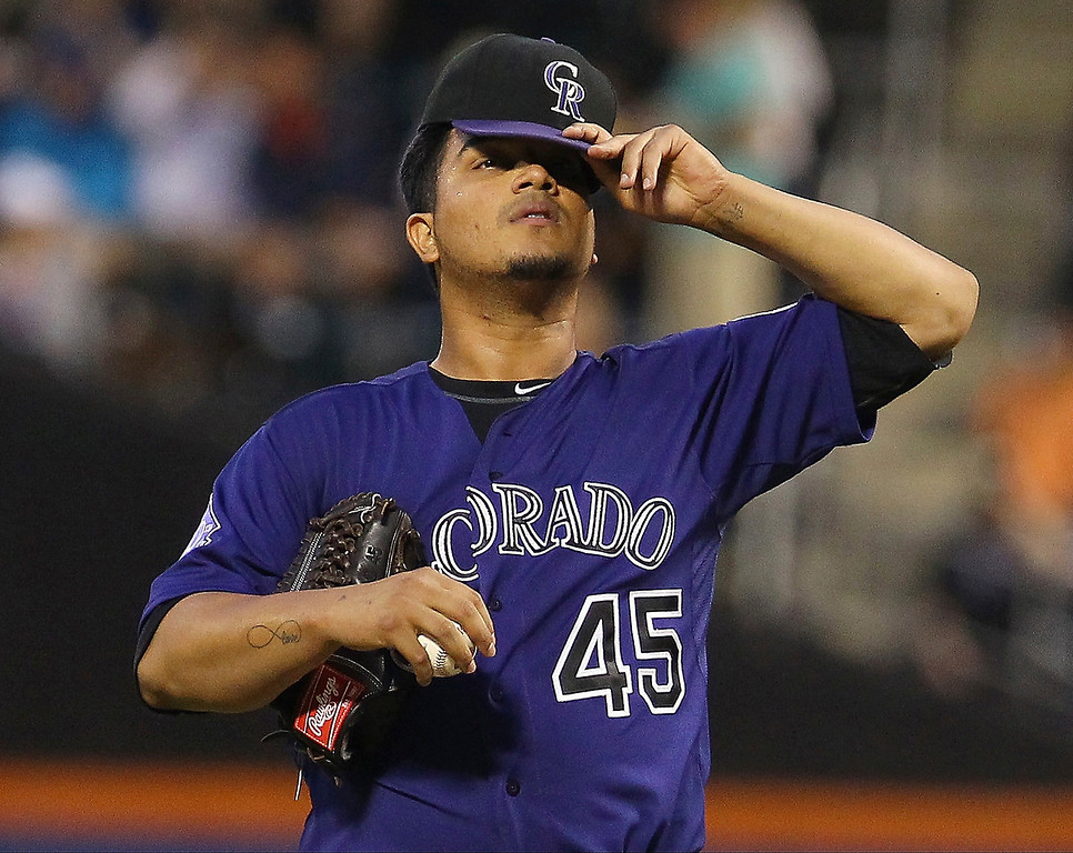 . Jhoulys Chacin #45 of the Colorado Rockies  reacts during the second inning against the New York Mets at Citi Field on August 7, 2013 at Citi Field in the Flushing neighborhood of the Queens borough of New York City.  (Photo by Mike Stobe/Getty Images)