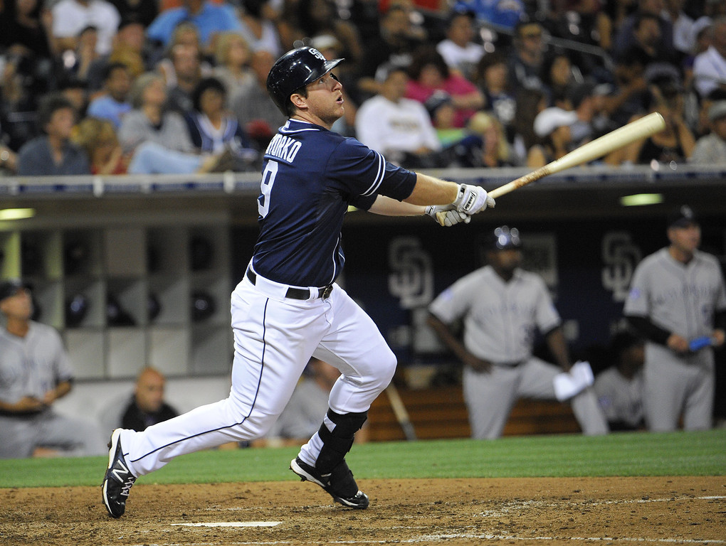 . SAN DIEGO, CA - SEPTEMBER 7:   Jedd Gyorko #9 of the San Diego Padres hits a solo home run during the eighth inning of a baseball game against the Colorado Rockies at Petco Park on September 7, 2013 in San Diego, California.  (Photo by Denis Poroy/Getty Images)