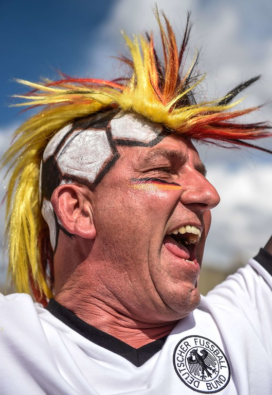 . A fan of Germany cheers outside Mineirao stadium, in Belo Horizonte, Brazil, a few hours before the start of the FIFA World Cup semi-final match between Brazil and Germany, on July 8, 2014.  AFP PHOTO / GUSTAVO  ANDRADE/AFP/Getty Images