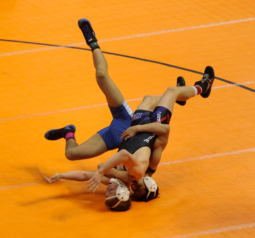 . DENVER, CO. - FEBRUARY 21: Baca County senior Clay Seemann, left, tangled with Center High School junior Jeremiah Moreno, right, during a consolation bout in class 2A Friday night. The CHSAA State Wrestling Tournament continued Friday, February 22, 2013 with quarterfinal and semifinal matches at the Pepsi Center in Denver. (Photo By Karl Gehring/The Denver Post)