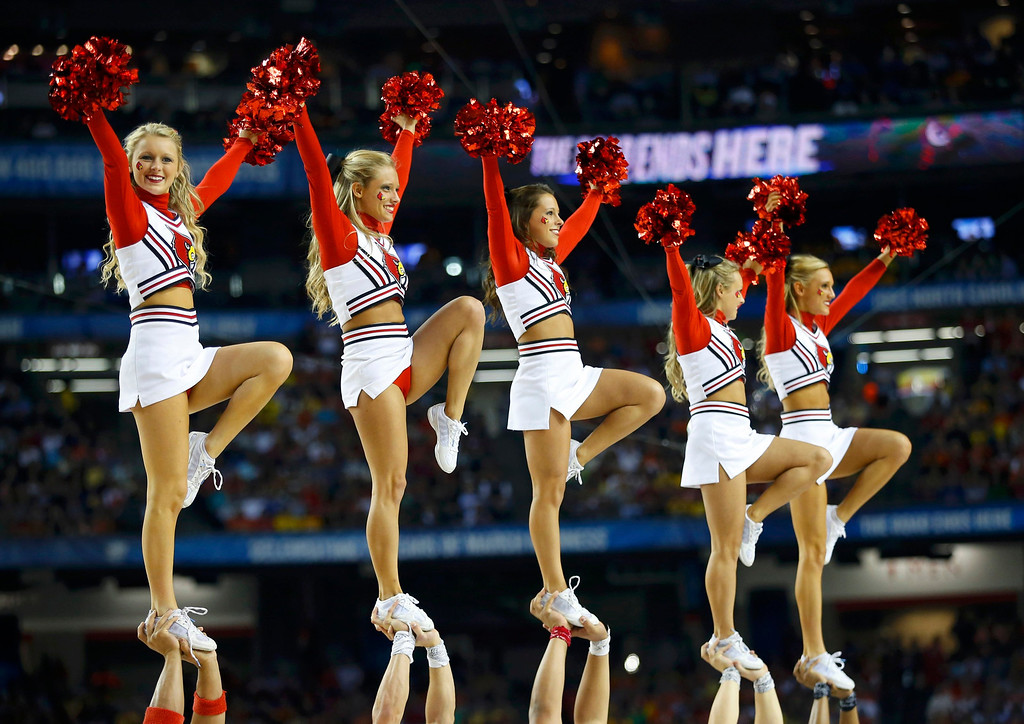 . Louisville Cardinals cheerleaders perform during the NCAA men\'s Final Four basketball game against the Wichita State Shockers in Atlanta, Georgia April 6, 2013. REUTERS/Jeff Haynes