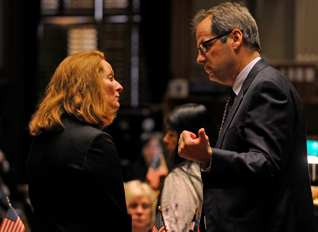 . DENVER, CO. - MARCH 8: Senator Morgan Carroll, left, meets with Bill Cadman on the Senate floor. Debate begins on the Senate floor at the state capitol on various gun bills before the state legislature. (Photo By Kathryn Scott Osler/The Denver Post)