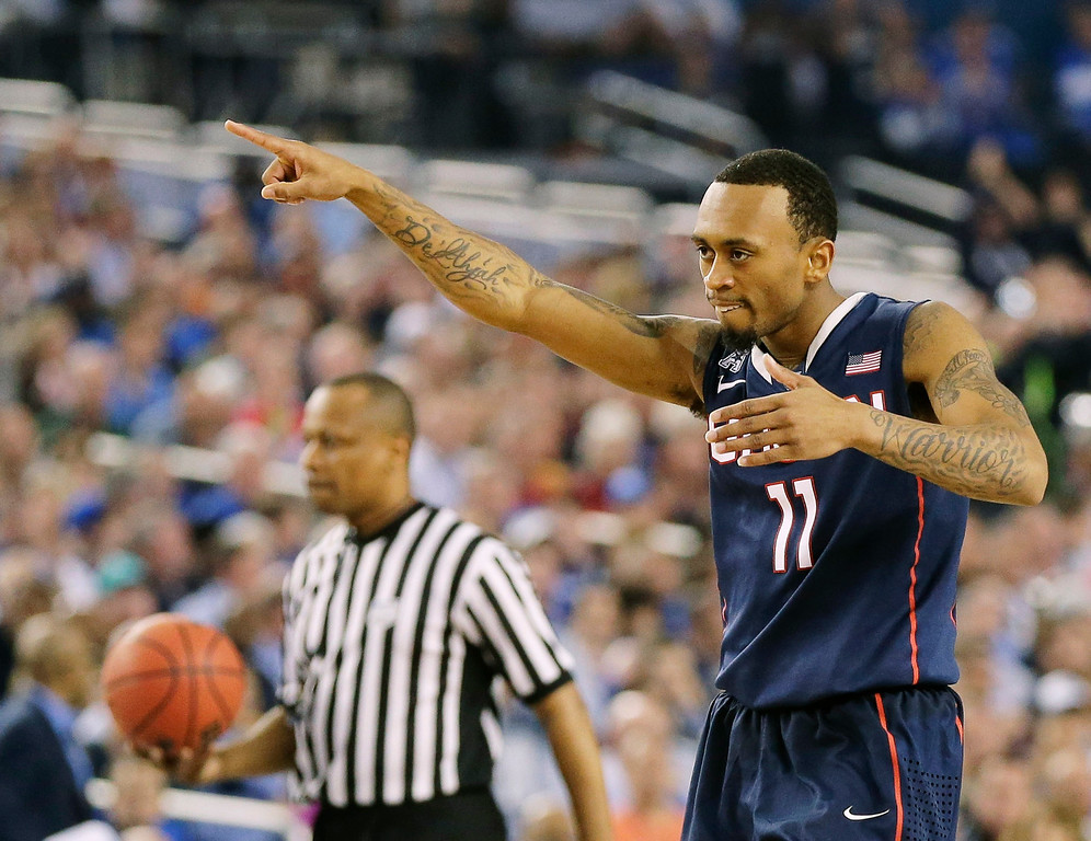 . Connecticut guard Ryan Boatright (11) celebrates as he walks down court against Florida during the second half of the NCAA Final Four tournament college basketball semifinal game Saturday, April 5, 2014, in Arlington, Texas. (AP Photo/Eric Gay)