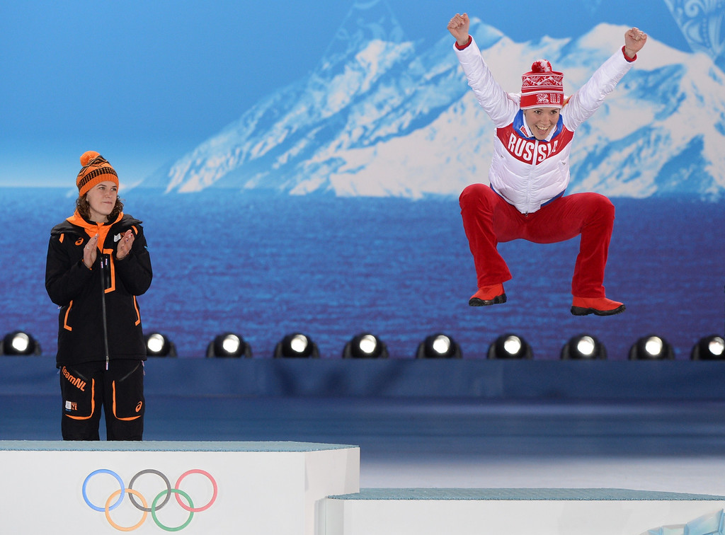 . Netherlands\' Irene Wust (L) looks at Russia\'s bronze medalist Olga Graf during the Women\'s Speed Skating 3000 m Medal Ceremony at the Sochi medals plaza during the Sochi Winter Olympics on February 10, 2014.  AFP PHOTO / ANTONIN THUILLIERANTONIN THUILLIER/AFP/Getty Images