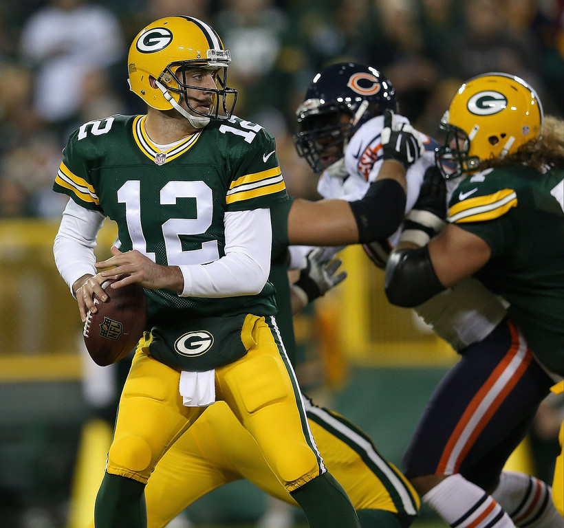 . Aaron Rodgers #12 of the Green Bay Packers looks to pass against the Chicago Bears at Lambeau Field on November 4, 2013 in Green Bay, Wisconsin.  (Photo by Jonathan Daniel/Getty Images)