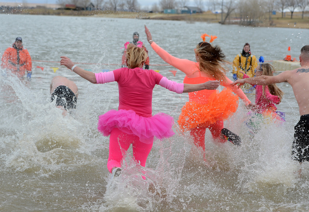 . Tutus were flying at the 31st annual Boulder Polar Plunge, at the Boulder Reservoir on New Year�s Day, to help the Boulder County AIDS Project and connectBCAP.  Cliff Grassmick/Daily Camera