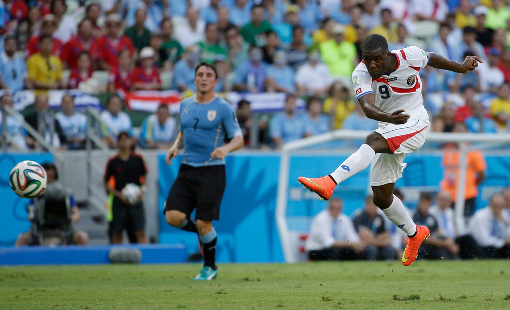 . Costa Rica\'s Joel Campbell takes a shot during the group D World Cup soccer match between Uruguay and Costa Rica at the Arena Castelao in Fortaleza, Brazil, Saturday, June 14, 2014. (AP Photo/Christophe Ena)