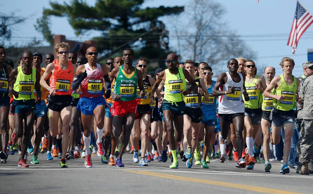 . The elite men\'s runners race near the start of the 118th Boston Marathon Monday, April 21, 2014 in Hopkinton, Mass. (AP Photo/Michael Dwyer)