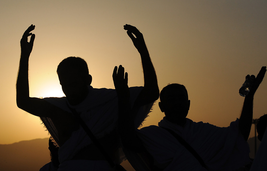 . Muslim pilgrims pray at sunrise on top of Mount Arafat, near the holy city of Mecca, ahead of the hajj main ritual, on October 14, 2013.  AFP PHOTO/FAYEZ NURELDINE/AFP/Getty Images
