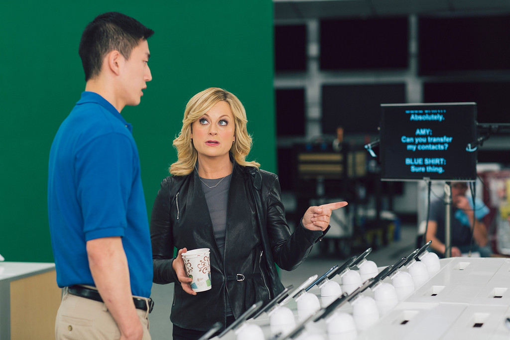 ". This  image provided by Best Buy, shows Amy Poehler on the set of the Company\'s Super Bowl commercial.  Best Buy\'s 30-second ad in the first quarter stars Amy Poehler, star of NBC\'s ""Parks and Rec,\"" asking a Best Buy employee \""lots of questions.\"" (AP Photo/Best Buy)"