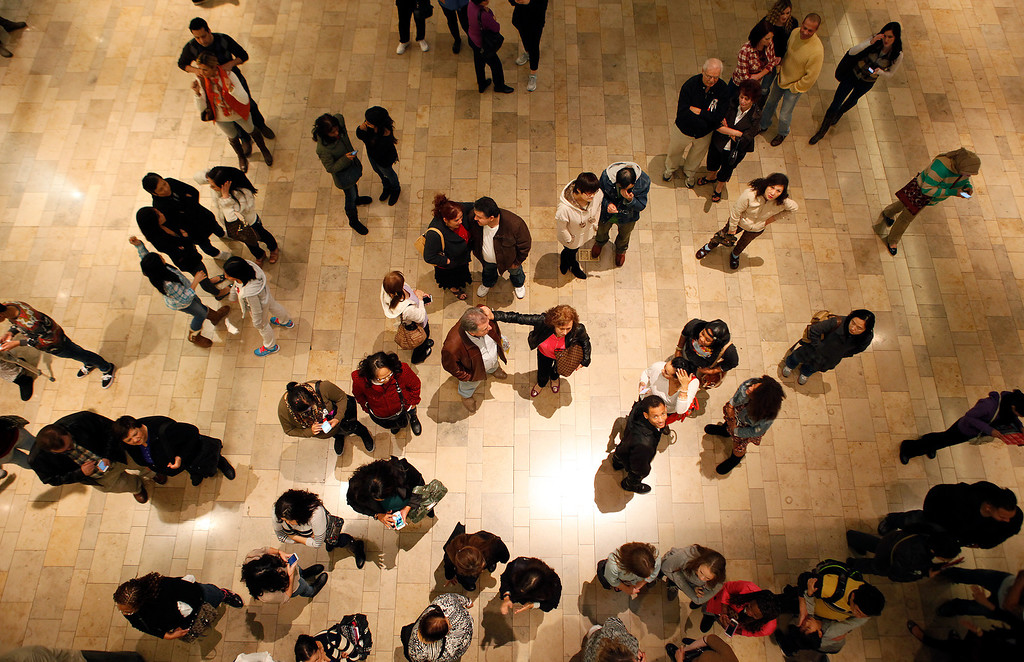 . A crowd of people waits for Macy\'s to open in the Fashion Show mall in Las Vegas Thursday, Nov. 28, 2013. Many of the stores in the mall opened late Thursday or at midnight for Black Friday. (AP Photo/Las Vegas Review-Journal, John Locher)