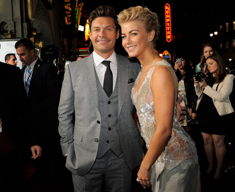 """. Julianne Hough, right, a cast member in \""""Safe Haven,\"""" poses with Ryan Seacrest at the U.S. premiere of the film, Tuesday, Feb. 5, 2013, in the Hollywood section of Los Angeles. (Photo by Chris Pizzello/Invision/AP)"""