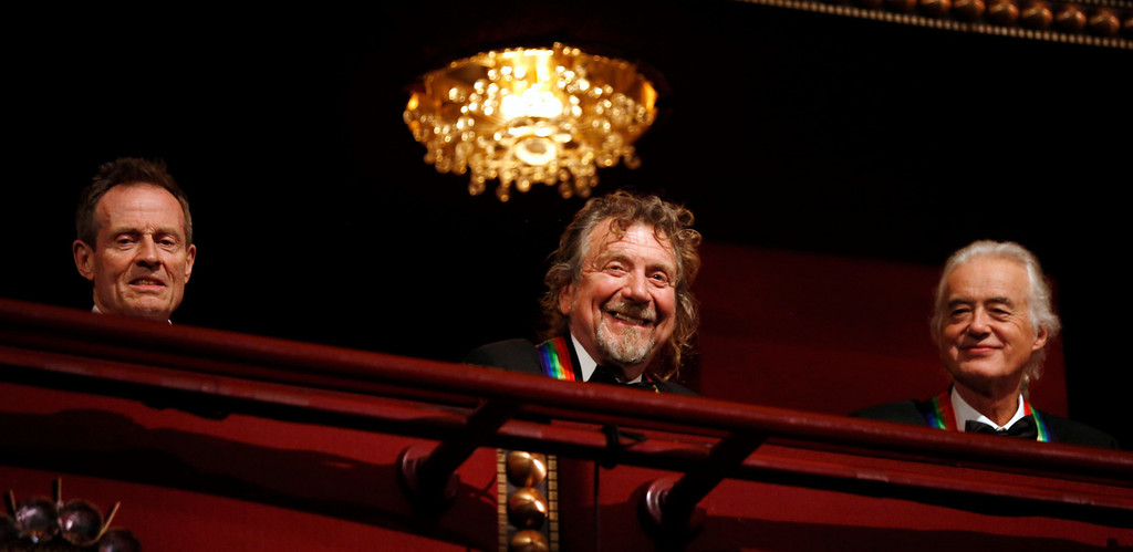 . Members of Led Zeppelin are pictured on the balcony of the Kennedy Center as 2012 honorees in Washington, December 2, 2012. (L-R) John Paul Jones, Robert Plant and Jimmy Page were among seven who were honored this year.   REUTERS/Jason Reed