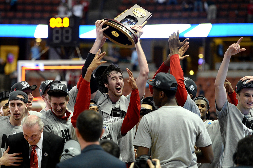 . Frank Kaminsky #44 of the Wisconsin Badgers celebrates with teammates after defeating the Arizona Wildcats 64-63 in overtime during the West Regional Final of the 2014 NCAA Men\'s Basketball Tournament at the Honda Center on March 29, 2014 in Anaheim, California.  (Photo by Harry How/Getty Images)