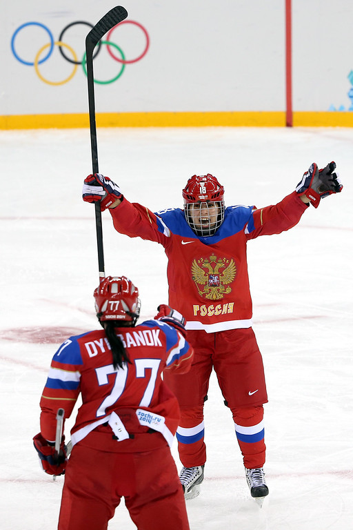 . SOCHI, RUSSIA - FEBRUARY 09:  Olga Sosina #18 of Russia celebrates with teammate Inna Dyubanok #77 after scoring a goal in the third period against Viona Harrer #27 of Germany during the Women\'s Ice Hockey Preliminary Round Group B Game on day two of the Sochi 2014 Winter Olympics at Shayba Arena on February 9, 2014 in Sochi, Russia.  (Photo by Bruce Bennett/Getty Images)