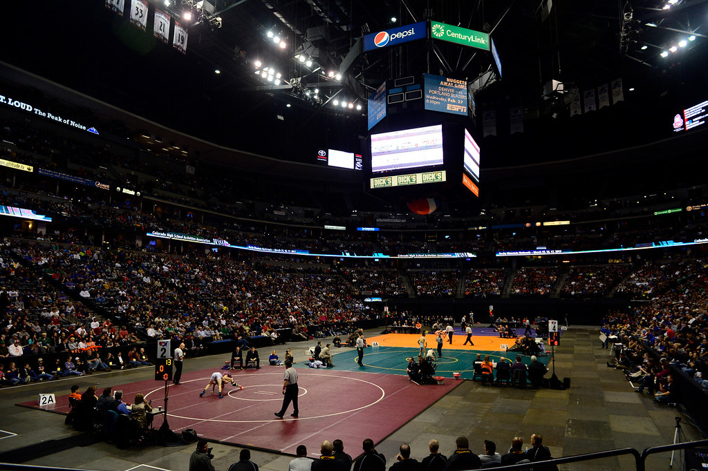 . DENVER, CO - FEBRUARY 23: . Wrestlers compete in the all-class finals during the Colorado State High School Wrestling Championships. The state\'s top wrestlers squared off in four classes in front of a near-capacity crowd at the Pepsi Center. (Photo by AAron Ontiveroz/The Denver Post)