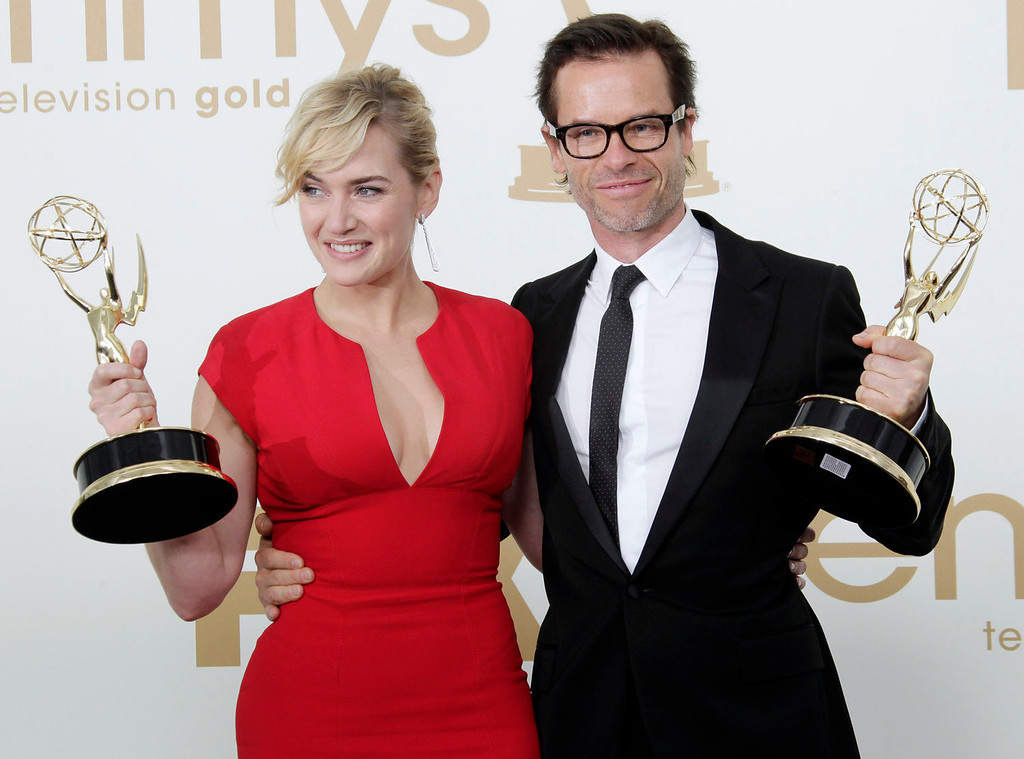 ". ""Mildred Pierce\"" cast members Kate Winslet, left and Guy Pearce hold the Emmys for best actress and best supporting actor in a miniseries or movie backstage at the 63rd Primetime Emmy Awards on Sunday, Sept. 18, 2011 in Los Angeles. (AP Photo/Jae Hong)"