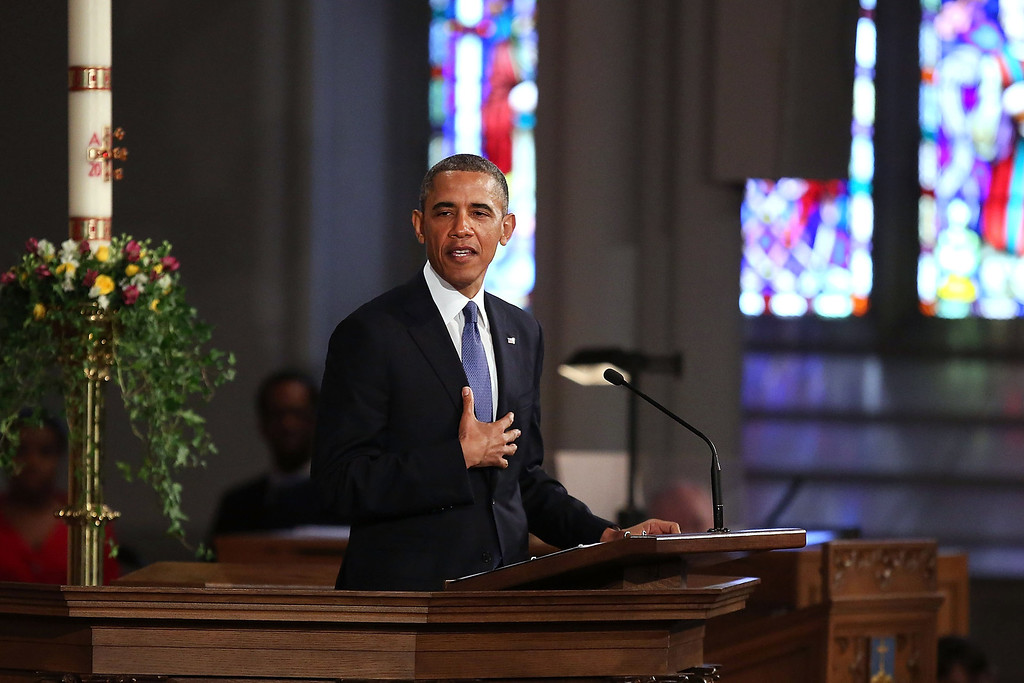""". President Barack Obama speaks at an interfaith prayer service for victims of the Boston Marathon attack titled \""""Healing Our City,\"""" at the Cathedral of the Holy Cross on April 18, 2013 in Boston, Massachusetts.  (Photo by Spencer Platt/Getty Images)"""