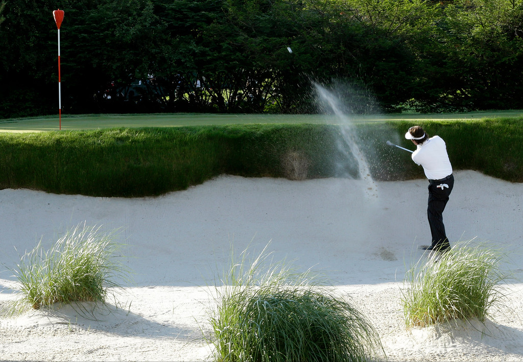 . Phil Mickelson hits out of a bunker during the second round of the U.S. Open golf tournament at Merion Golf Club, Friday, June 14, 2013, in Ardmore, Pa. (AP Photo/Julio Cortez)