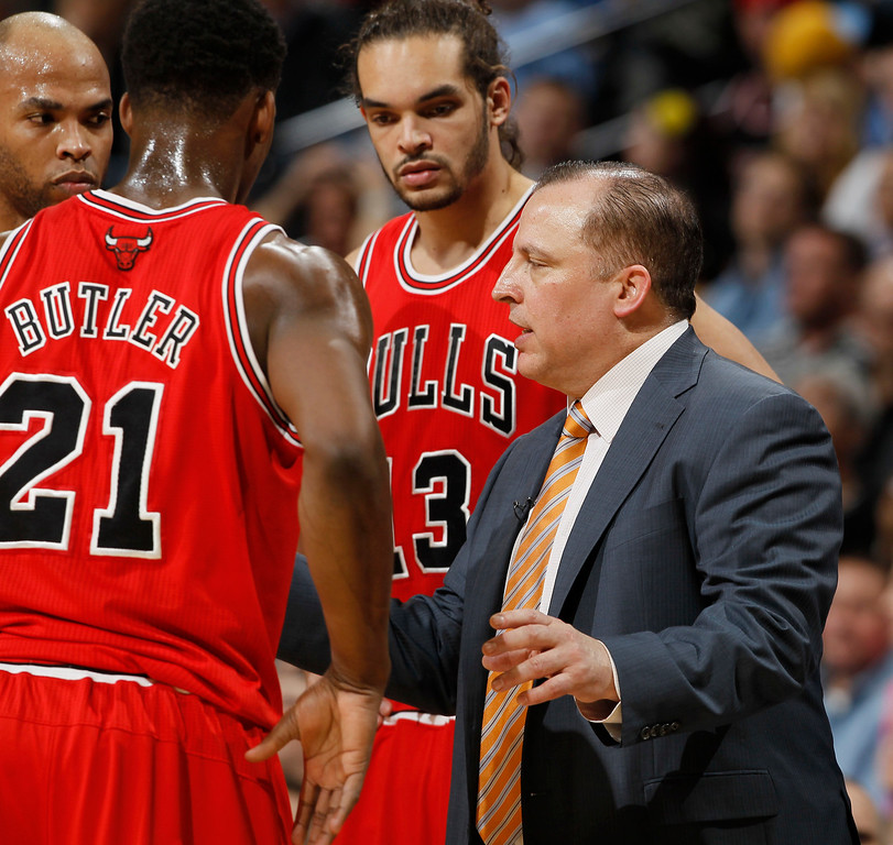 . Chicago Bulls head coach Tom Thibodeau, right, confers with Jimmy Butler, front left, Taj Gibson, back left, and Joakim Noah during a time out against the Denver Nuggets in the second quarter of an NBA basketball game in Denver on Thursday, Feb. 7, 2013. (AP Photo/David Zalubowski)