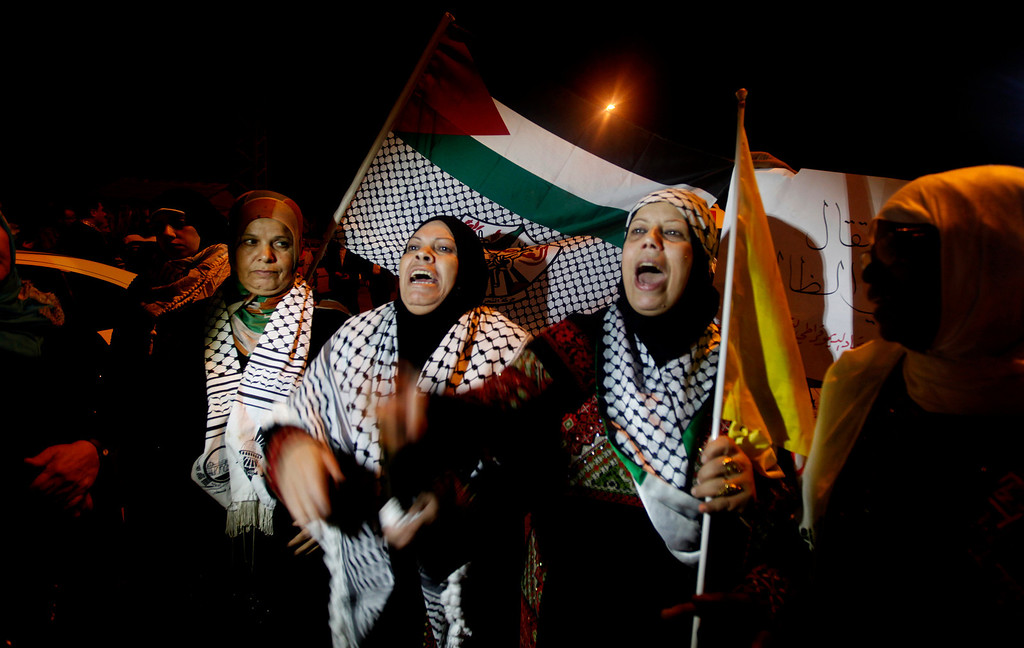 . Palestinian relatives during a celebrate while waiting for his release at the checkpoint at the entrance of Beit Hanoun between north of Gaza Strip and Israel, Tuesday, Oct. 29, 2013. Israel agreed release is part of a U.S.-brokered agreement that restarted peace talks with the Palestinians over the summer. It is the second of four planned releases of the longest-serving Palestinian prisoners held by Israel in the coming months. (AP photo/Hatem Moussa)