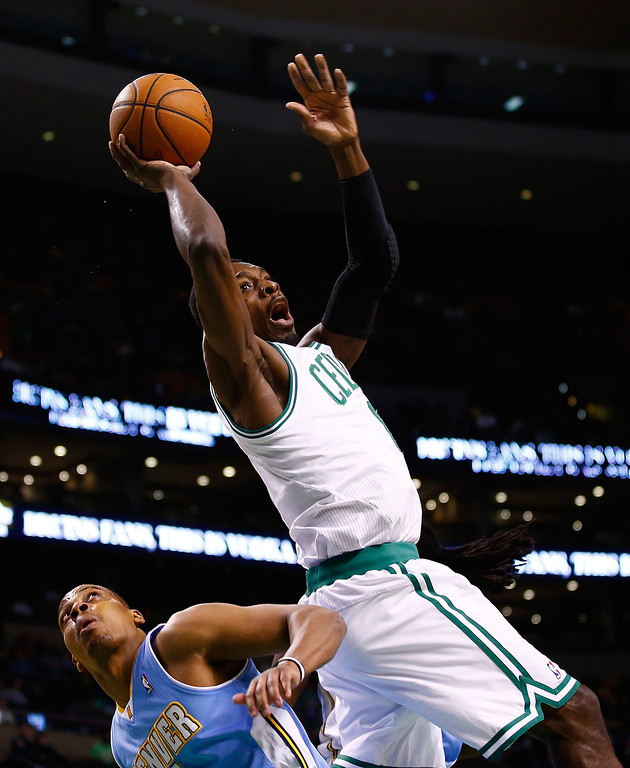 . BOSTON, MA - DECEMBER 06: Jeff Green #8 of the Boston Celtics is fouled on his way to the basket against the Denver Nuggets in the first quarter during the game at TD Garden on December 6, 2013 in Boston, Massachusetts.  (Photo by Jared Wickerham/Getty Images)