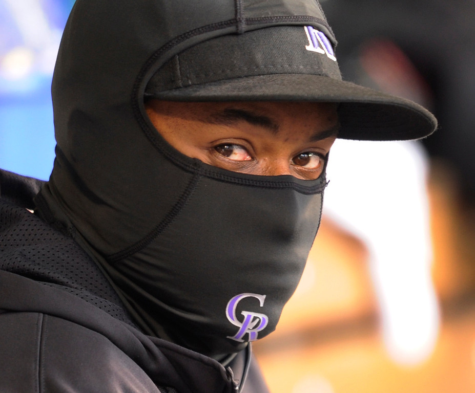 . DENVER, CO. - APRIL 23:  Colorado infielder Chris Nelson did his best to stay warm on the bench Tuesday night. The Colorado Rockies hosted the Atlanta Braves in the second game of a doubleheader Tuesday night April 23, 2013 at Coors Field. Photo By Karl Gehring/The Denver Post
