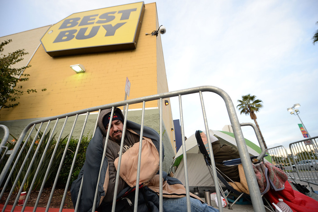 . A man sleeps in a chair as he waits in line for the doors to open on Thanksgiving Day at the Best Buy store in Burbank, California November 28, 2013. More than a dozen US retailers will open their doors to shoppers one day ahead of the famed-Black Friday shopping day.  ROBYN BECK/AFP/Getty Images
