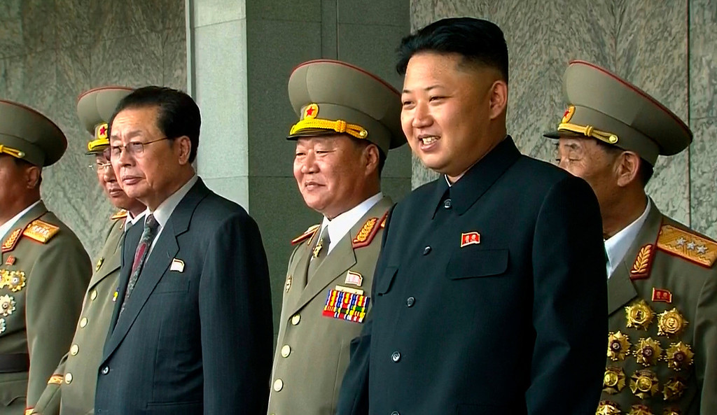 . In this image taken from video North Korean leader Kim Jong Un, second from right, smiles while watching a military parade marking the 65th anniversary of the country\'s founding, Monday, Sept. 9, 2013, in Pyongyang, North Korea. (AP Photo/KRT via AP Video)