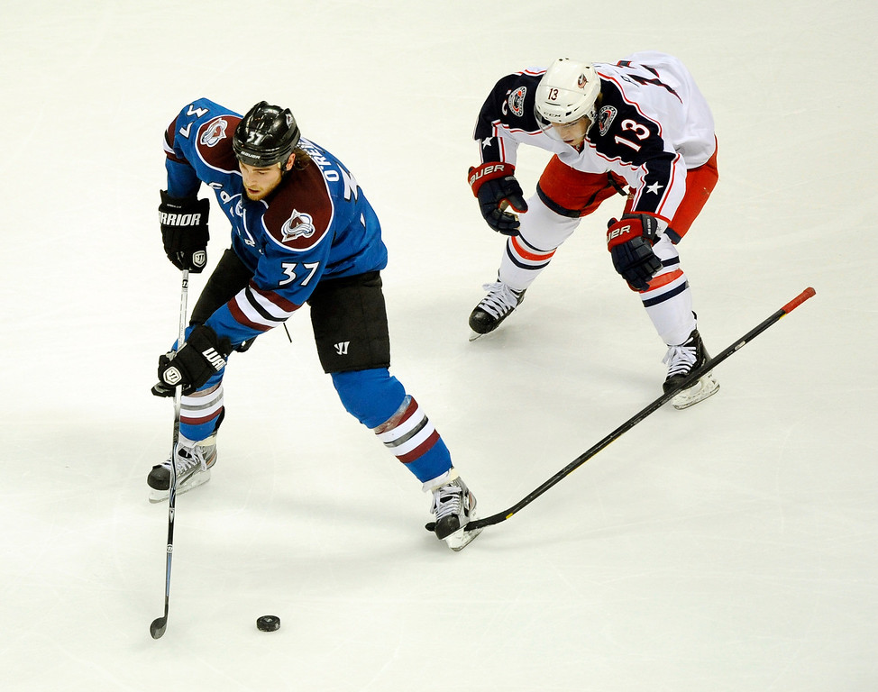 . Columbus wing Cam Atkinson (13) got his stick stuck in the skate of Colorado\'s Ryan O\'Reilly (37) in the first period. The Colorado Avalanche hosted the Columbus Blue Jackets at the Pepsi Center Thursday night,  April 4, 2011. Karl Gehring/The Denver Post