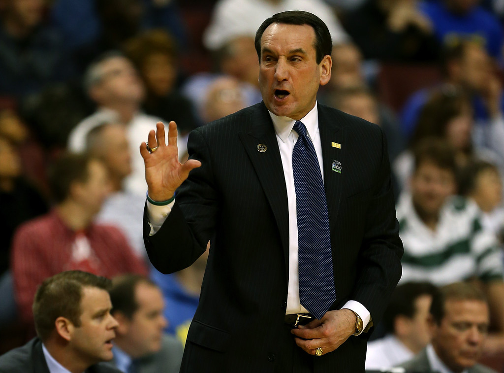. Head coach Mike Krzyzewski of the Duke Blue Devils calls out in the first half while taking on the Albany Great Danes during the second round of the 2013 NCAA Men\'s Basketball Tournament on March 22, 2013 at Wells Fargo Center in Philadelphia, Pennsylvania.  (Photo by Elsa/Getty Images)