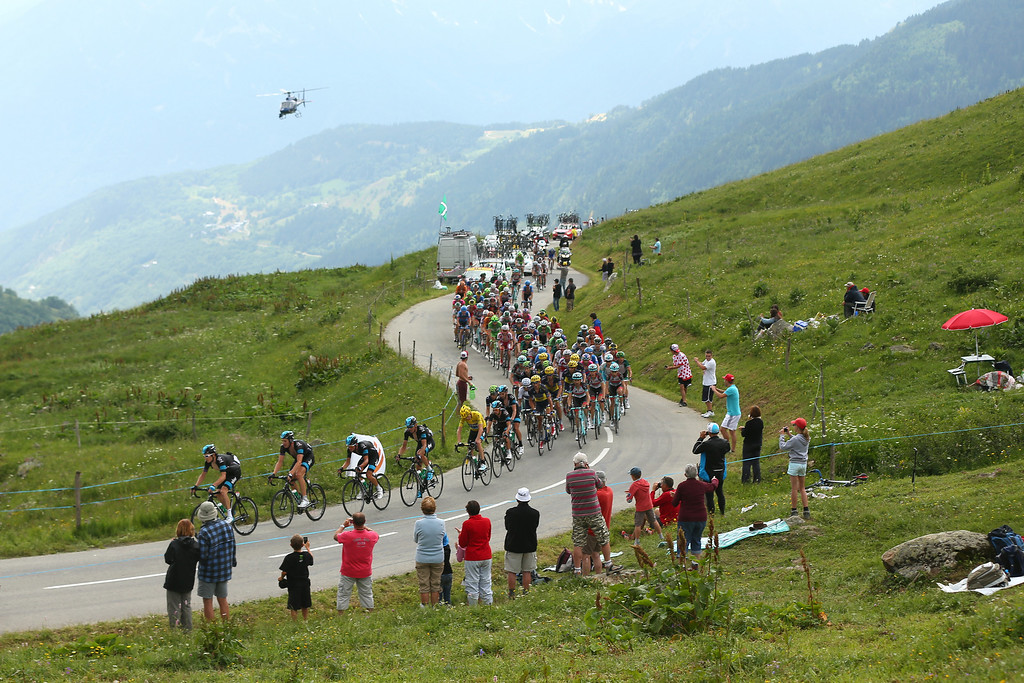 . The peloton in action during stage nineteen of the 2013 Tour de France, a 204.5KM road stage from Bourg d\'Oisans to Le Grand Bornand, on July 19, 2013 in Le Grand Bornand, France.  (Photo by Bryn Lennon/Getty Images)