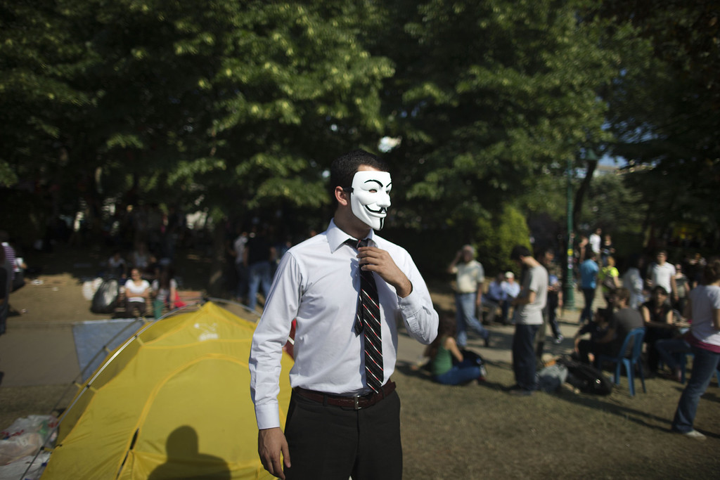 . A protestor wears a mask at the Gezi Park in Taksim Square on June 4, 2013 in Istanbul, Turkey.  (Photo by Uriel Sinai/Getty Images)