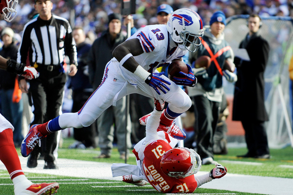 . Buffalo Bills wide receiver Steve Johnson (13) is tackled by Kansas City Chiefs cornerback Marcus Cooper (31) during the second quarter of an NFL football game in Orchard Park, N.Y., Sunday, Nov. 3, 2013. (AP Photo/Gary Wiepert)