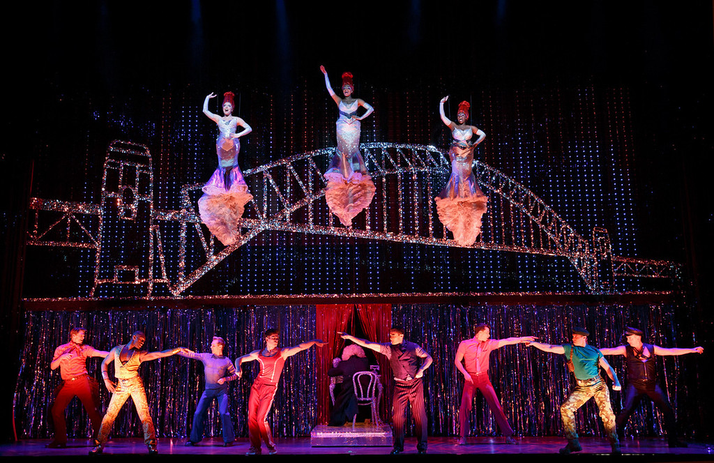 """. Flying at the top of the photo are, from left to right, Emily Afton, Brit West and Bre Jackson during ìItís Raining Men\"""" at \""""Priscilla Queen of the Desert the Musical,\"""" which will be at the Buell Theatre Sept. 3-15.  (Photo by Joan Marcus, Provided by Denver Center Attractions)"""