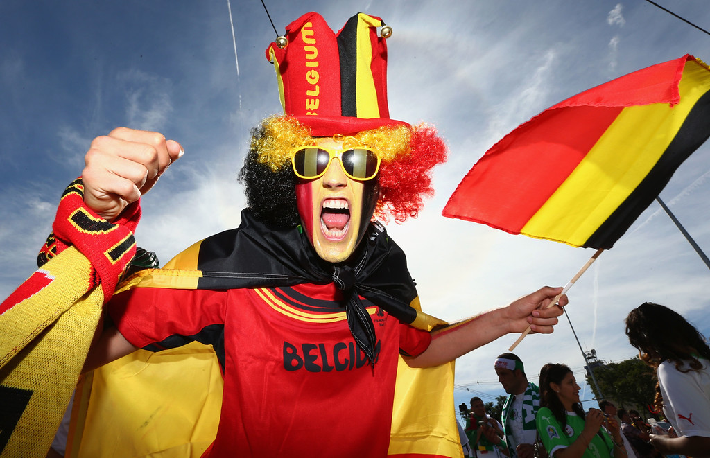 . A face painted Belgium fan enjoys the atmosphere prior to the 2014 FIFA World Cup Brazil Group H match between Belgium and Algeria at Estadio Mineirao on June 17, 2014 in Belo Horizonte, Brazil.  (Photo by Quinn Rooney/Getty Images)