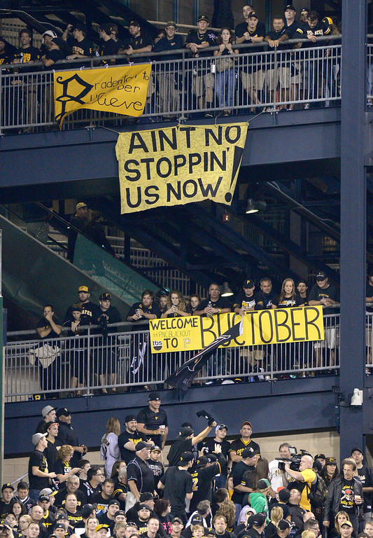 . Banners supporting the Pittsburgh Pirates hang from the left field rotunda as the Pirates play the Cincinnati Reds in the NL wild-card playoff baseball game Tuesday, Oct. 1, 2013, in Pittsburgh. (AP Photo/Don Wright)