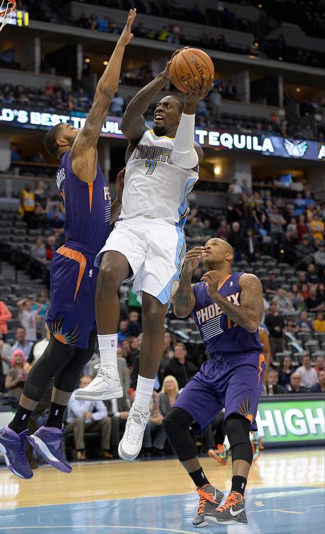 . Denver Nuggets power forward J.J. Hickson (7) drives on Phoenix Suns Markieff Morris (11) during the first quarter October 23, 2013 at Pepsi Center. (Photo By John Leyba/The Denver Post)