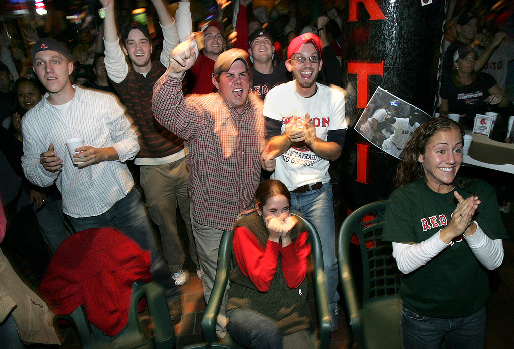 . Boston Red Sox fans, in a bar near Fenway Park in Boston, react to Trot Nixon\'s two-RBI double in the third inning against the St. Louis Cardinals, Wednesday, Oct. 27, 2004 in Game 4 of the World Series. (AP  Photo/Michael Dwyer)