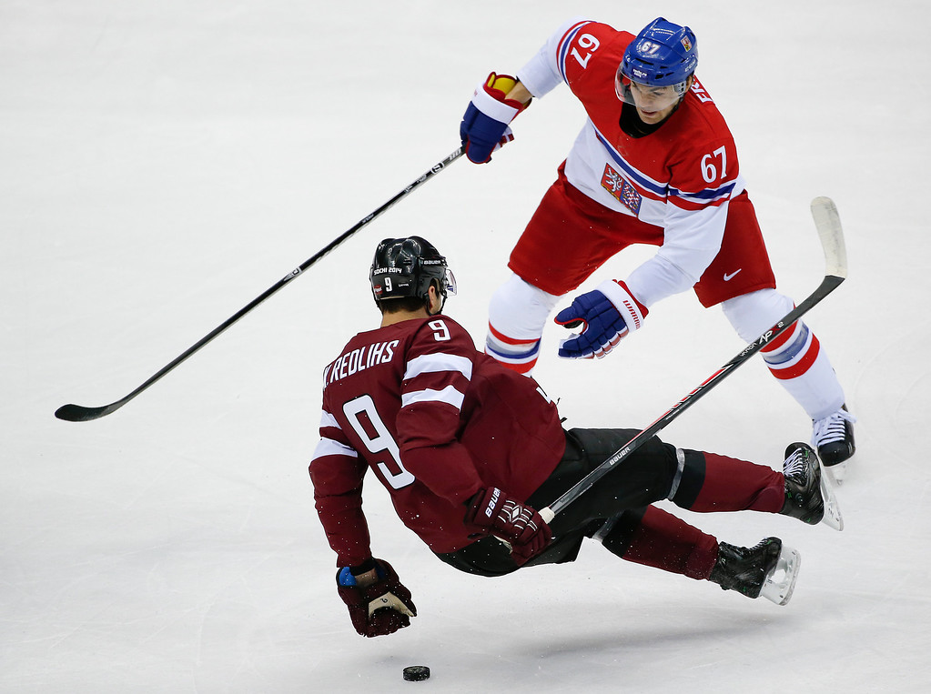 . Czech Republic forward Michael Frolik collides with Latvia defenseman Krisjanis Redlihs in the first period of a men\'s ice hockey game at the 2014 Winter Olympics, Friday, Feb. 14, 2014, in Sochi, Russia. (AP Photo/Julio Cortez)