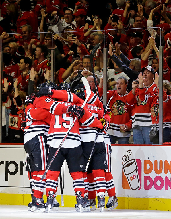 . Chicago Blackhawks celebrate after right wing Patrick Kane scored a goal during the third period in Game 5 of the NHL hockey Stanley Cup playoffs Western Conference finals against the Los Angeles Kings, Saturday, June 8, 2013, in Chicago. (AP Photo/Nam Y. Huh)
