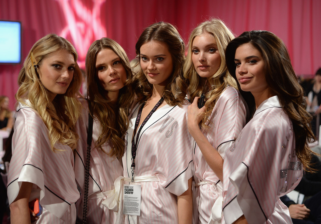 . (L-R) Models Martha Hunt, Caroline Brasch, Monika Jagaciak, Elsa Hosk, and Sara Sampaio prepare at the 2013 Victoria\'s Secret Fashion Show hair and make-up room at Lexington Avenue Armory on November 13, 2013 in New York City.  (Photo by Dimitrios Kambouris/Getty Images for Victoria\'s Secret)