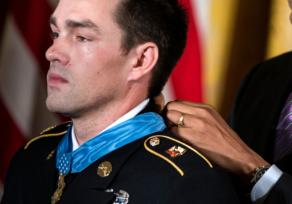 . US President Barack Obama awards former US Army Staff Sargent Clinton Romesha the Medal of Honor during a ceremony in the East Room of the White House February 11, 2013 in Washington, DC.   AFP PHOTO/Brendan  SMIALOWSKI/AFP/Getty Images