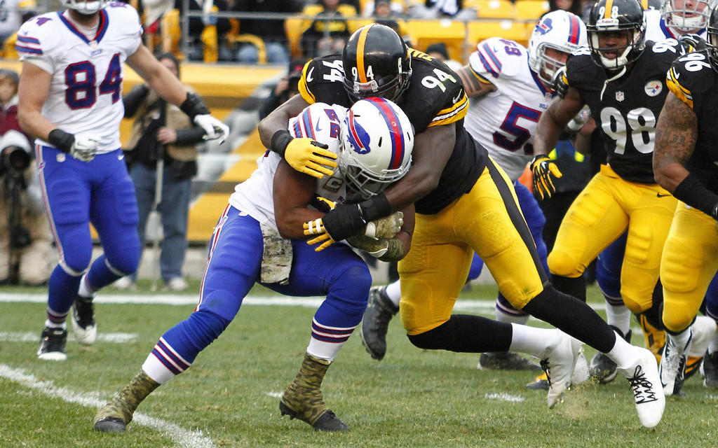 . Lawrence Timmons #94 of the Pittsburgh Steelers tackles Fred Jackson #22 of the Buffalo Bills during the game on November 10, 2013 at Heinz Field in Pittsburgh, Pennsylvania.  (Photo by Justin K. Aller/Getty Images)